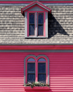 Attic dormer on red house